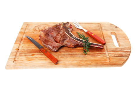savory : grilled spare rib on wooden plate with thyme isolated over white background photo