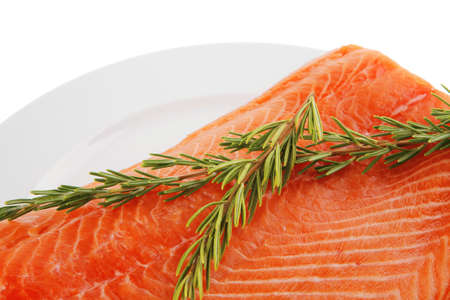 raw big salmon bar on white plate and rosemary Stock Photo - 17737975