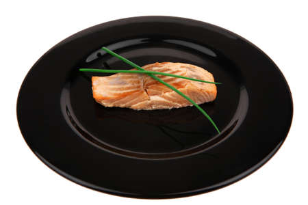 savory fish portion : norwegian salmon fillet roasted with green chinese onion, on black dish isolated over white background Stock Photo - 17733660
