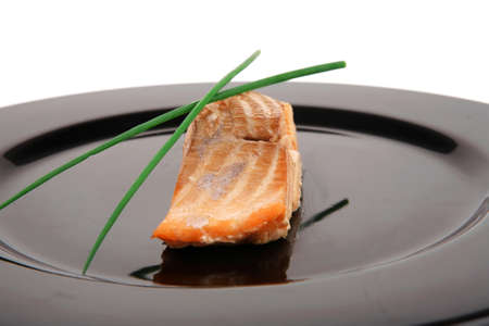 sea food : roasted pink salmon fillet with chinese onion, on black dish isolated over white background Stock Photo - 17829799