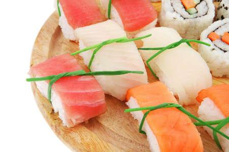 nigiri: Maki Sushi and Nigiri - California Maki Roll made of fresh raw Salmon, Cream Cheese and Avocado inside with Nigiri Sushi topped with Salmon Tuna and Eel. Isolated over white background