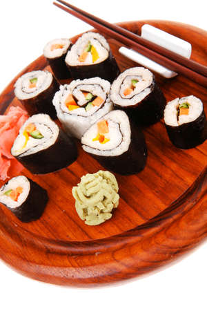 maguro: Japanese Traditional Cuisine - California Roll with Salmon (sake), Cream Cheese and Tuna (maguro) . on wooden plate with wasabi and ginger isolated over white background