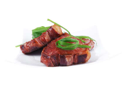 roasted beef meat strips steak on white ceramic plate isolated over white background Stock Photo - 18070908