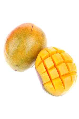 mango fruit: fresh raw carved mango isolated over white background Stock Photo