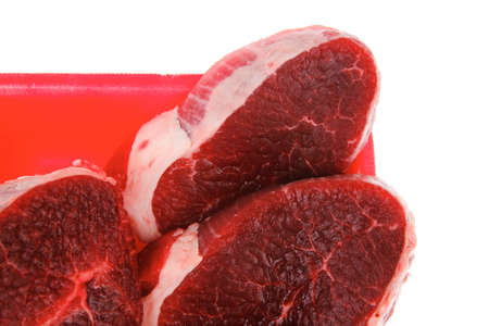 uncooked meat : raw fresh beef pork tenderloin strip ready to cooking on red tray isolated over white background photo