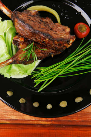 main course: barbecued ribs served with capers and chives Stock Photo - 18340811