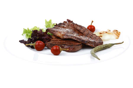 frame less: meat food : two grilled steak with chili and red peppers , green lettuce salad , on dish isolated over white background Stock Photo