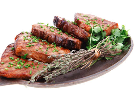 barbecued beef meat on pan isolated on white background photo