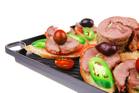 snakes on grill plate : tartlets with sliced meat and supplements isolated over white background Stock Photo - 18554295