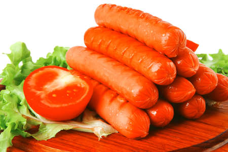 served grilled beef red sausages on wooden plate photo