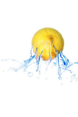 yellow lemon fall in real blue water splash isolated over white background photo