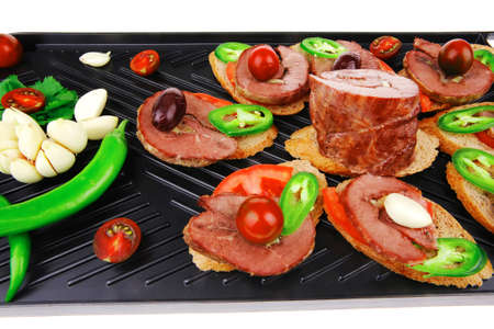snakes on plate : tartlets with meat and vegetables isolated on white Stock Photo - 18669256