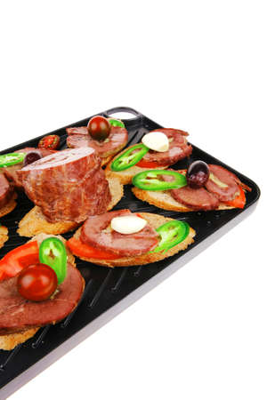 snakes on black teflon grill plate : meaty tartlets with supplements isolated over white background Stock Photo - 18693668