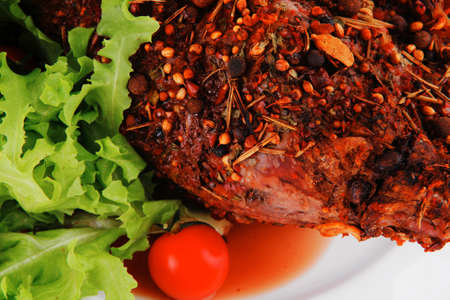 meat chunk and salad on white plate photo