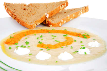 homemade cuisine : isolated salmon vegetable soup with bread and chives photo