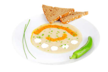 homemade cuisine : isolated salmon vegetable soup served with bread and chives photo