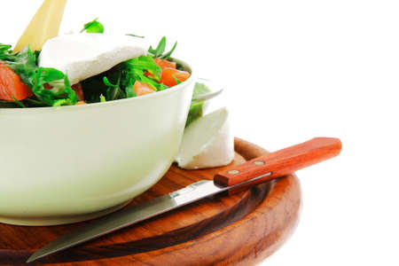 fresh green salad with smoked salmon in green bowl photo