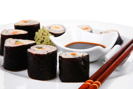 Maki Sushi : Maki Rolls and California rolls made of fresh raw Salmon(sake), Tuna(maguro) and Eel(unagi) . on white dish with sticks isolated over white background Stock Photo - 19370432