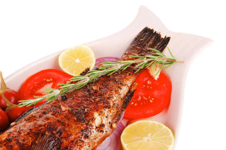 fryed: savory: whole fryed sunfish over plate with tomatoes lemons and peppers
