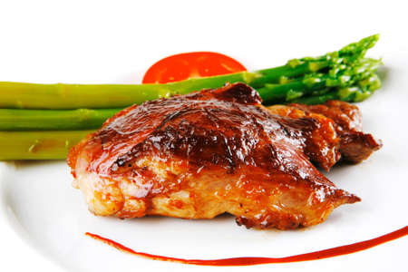 bbq chicken: roast beef meat served with asparagus on white Stock Photo
