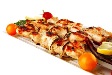 bbq chicken: fresh roast shish kebab on white platter