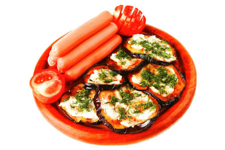 sausages served on wooden plate with grilled eggplant photo