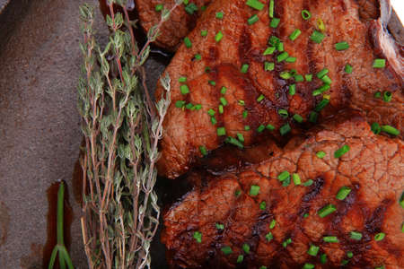 fresh ripe grilled beef meat on pan isolated on white background photo