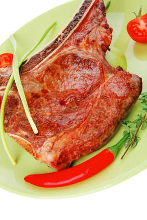 savory : grilled spare rib on green dish with thyme pepper and tomato isolated over white background photo