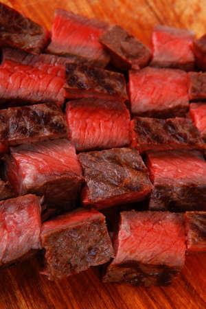 american meat : big rare roast steak on wood isolate on white background photo