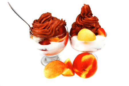fruits with chocolate ice cream over white photo