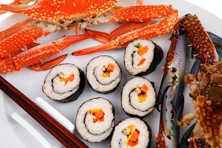 philadelphia roll: Maki Sushi : Maki Rolls and California rolls made of fresh raw Salmon, Tuna and Eel . on black dish with red and blue crabs . Stock Photo