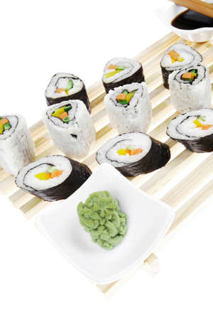 California Roll with Avocado and Salmon, Cream Cheese and Raw Salmon inside. on wooden grid . isolated over white background . Maki Sushi and Sashimi photo