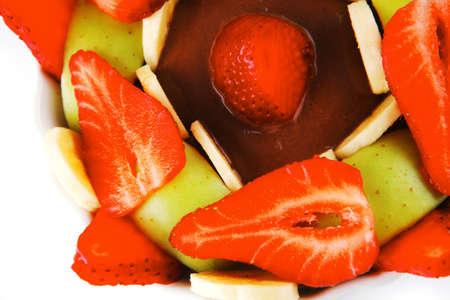 served fresh strawberries and slices over white plate photo
