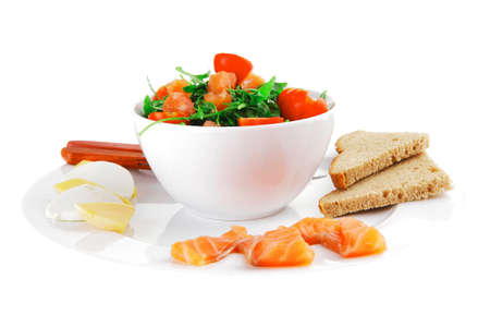baby cutlery: green salad with smoked salmon in white bowl on plate