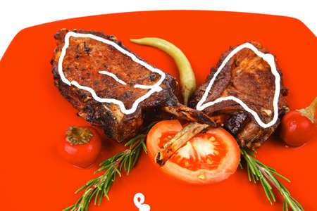 savory plate: grilled ribs over red with peppers and rosemary photo
