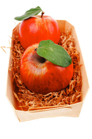 over packed: red fresh ripe twins apple packed with wooden box isolated over white background