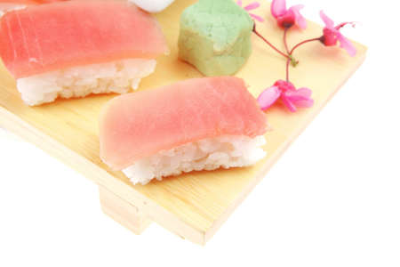 maguro: Japanese Cuisine - Set of Nigiri sushi topped with raw Tuna (maguro) . on wooden board . isolated over white background