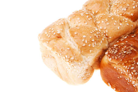 fresh loaf of light wheat bread topped by sesame seeds isolated over white background photo