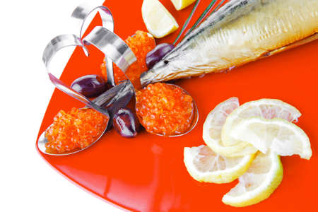 golden fish with lemon and olives on red photo