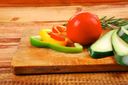 uncooked vegetables with olive oil over wooden table photo