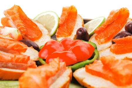 smoked salmon on baguette with olives and pepper photo