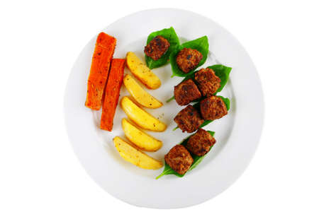 grilled meatballs on white plate with basil and potatoes Stock Photo - 20565508