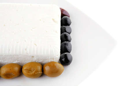 image of feta cube on plate with rare olives Stock Photo - 20592110