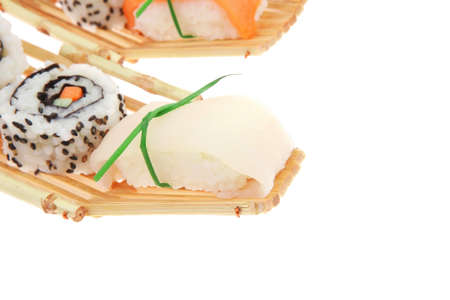 Japanese traditional Cuisine - Roll with Cucumber , Cream Cheese and Raw Salmon inside. Sashimi topped Smoked Salmon and raw Eel . Isolated over white background photo