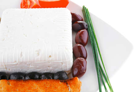 image of feta cheese on white plate photo