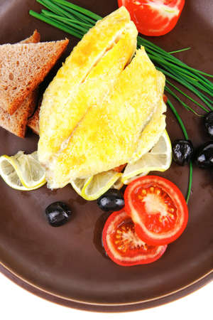 served roast golden fish fillet with tomatoes, rye bread and olives photo