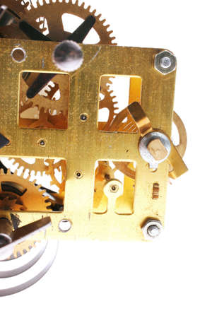 image of clock mechanism inside over white background photo