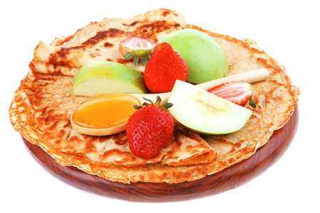 baked food : pancake with honey strawberries and apple isolated on white background photo