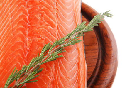 raw big salmon bar on wood plate and rosemary photo
