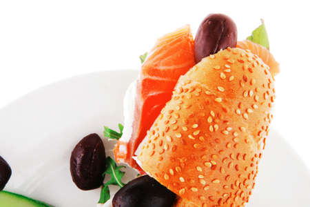salmon sandwich and olives on green dish photo